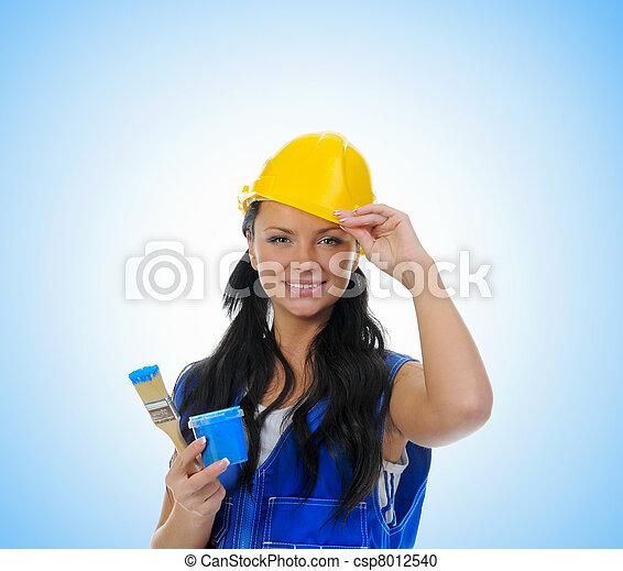 Beautiful young woman doing repairs - csp8012540