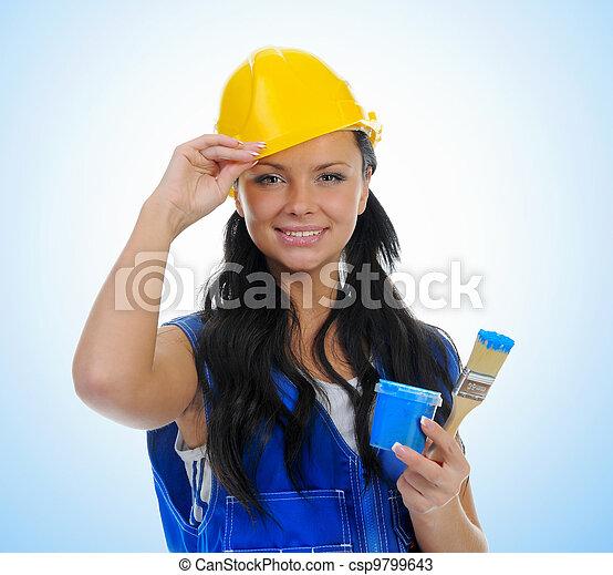 Beautiful young woman doing repairs - csp9799643