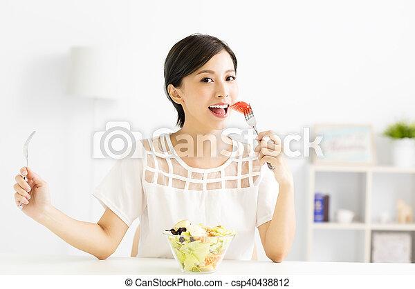 beautiful  young woman eating healthy food - csp40438812