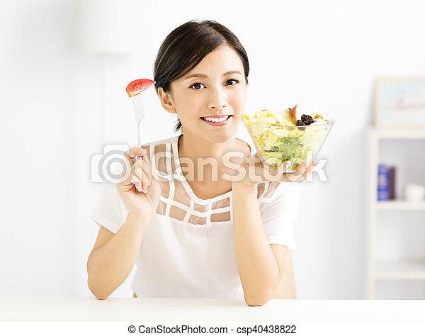 beautiful  young woman eating healthy food - csp40438822