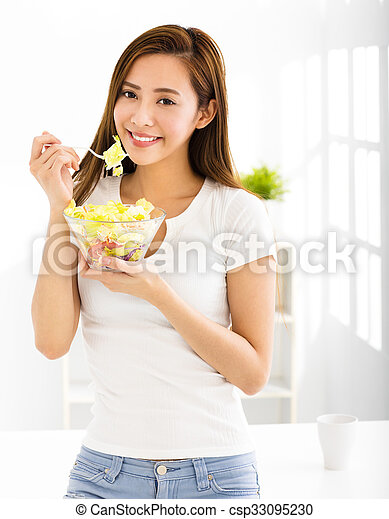 beautiful young woman eating healthy food - csp33095230