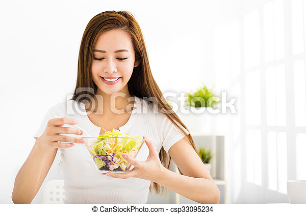 beautiful young woman eating healthy food - csp33095234