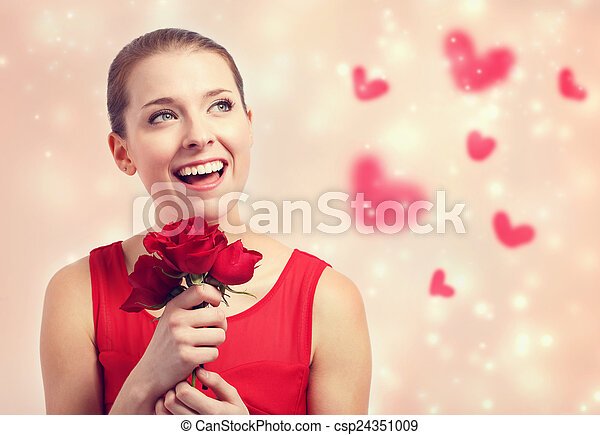 Beautiful young woman holding red roses - csp24351009
