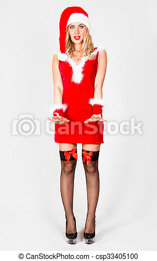 786fa36eea9e Beautiful young woman in a christmas clothes over grey background.