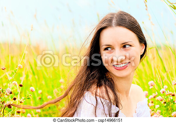 beautiful young woman in a field of flowers - csp14966151