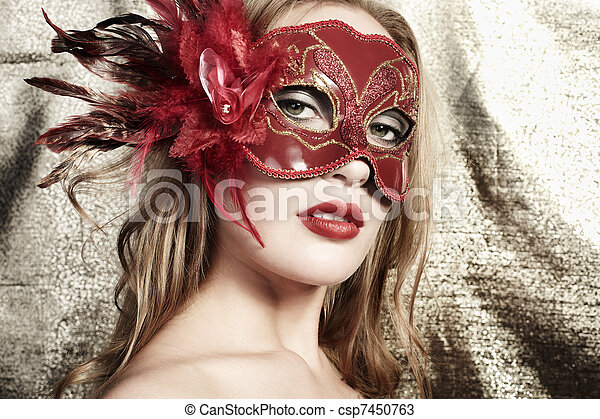 230a47779757e Beautiful young woman in a red mysterious venetian mask on a gol.