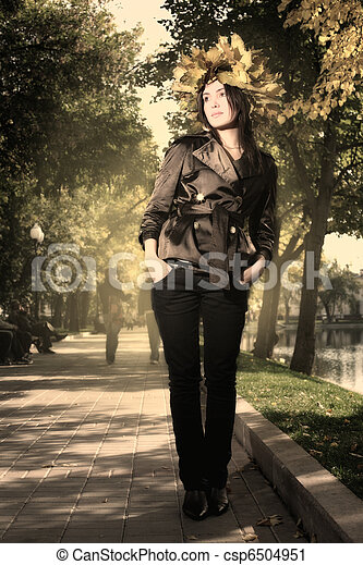 Beautiful young woman in autumn park - csp6504951