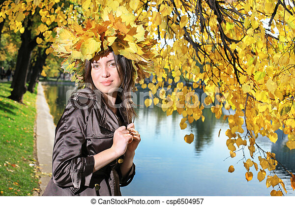 Beautiful young woman in autumn park - csp6504957