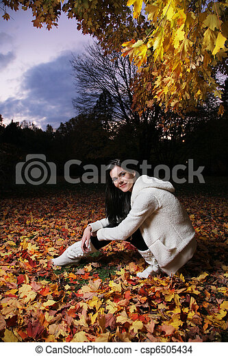 Beautiful young woman in autumn park. - csp6505434