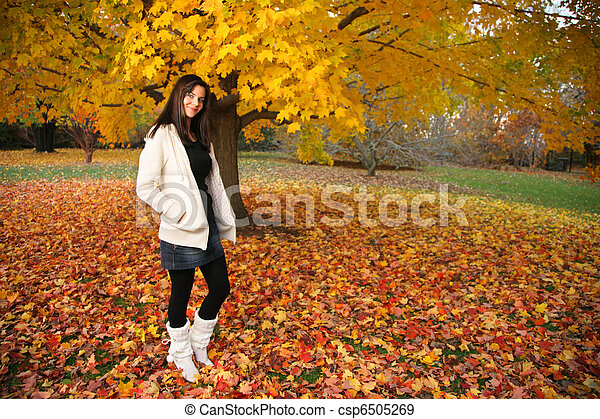 Beautiful young woman in autumn park. - csp6505269