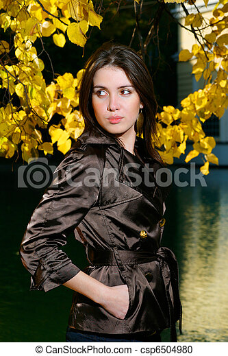 Beautiful young woman in autumn park - csp6504980