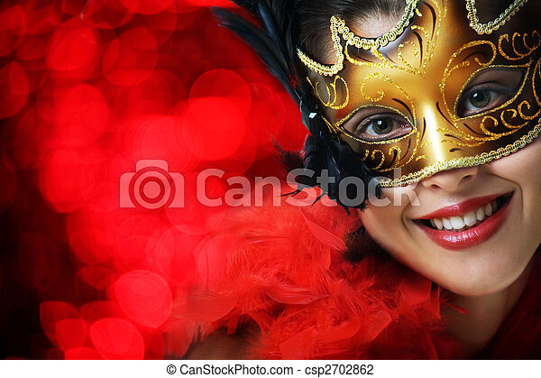 Beautiful young woman in carnival mask - csp2702862