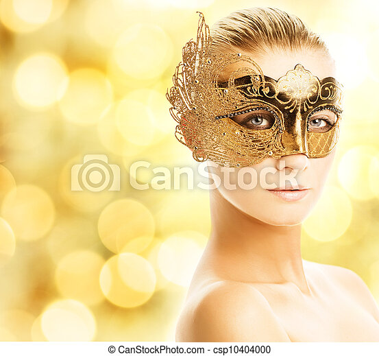 Beautiful young woman in carnival mask - csp10404000
