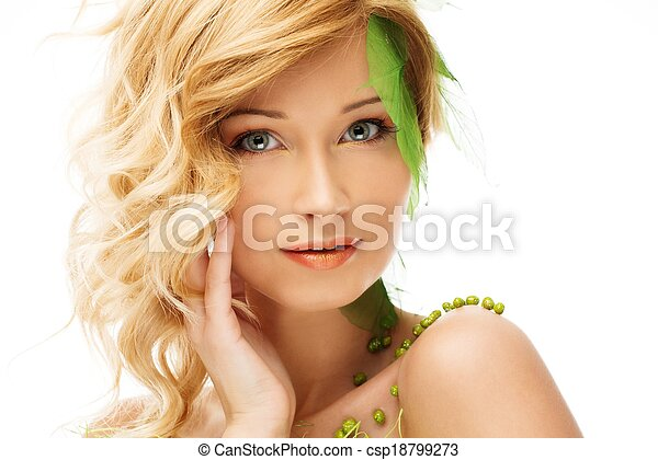 Beautiful young woman in conceptual spring costume touching her face  - csp18799273