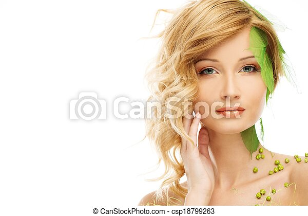 Beautiful young woman in conceptual spring costume touching her face  - csp18799263