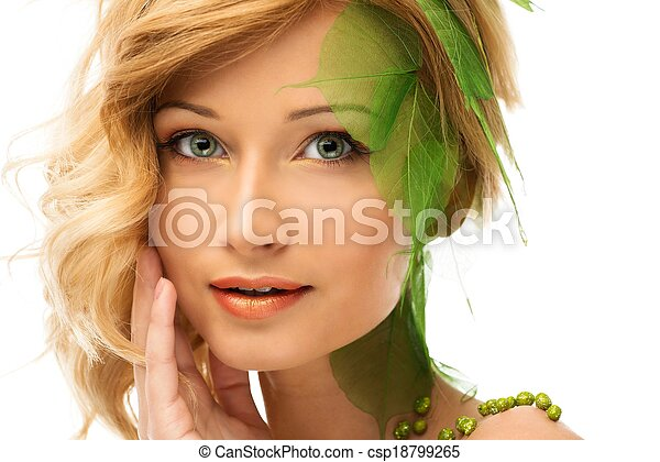 Beautiful young woman in conceptual spring costume touching her face  - csp18799265