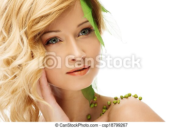 Beautiful young woman in conceptual spring costume touching her face  - csp18799267