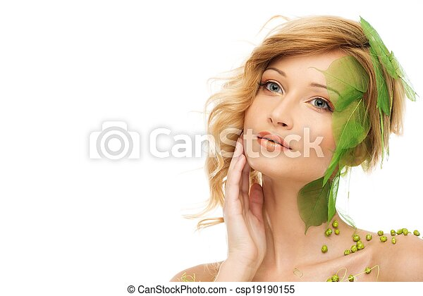 Beautiful young woman in conceptual spring costume touching her face  - csp19190155
