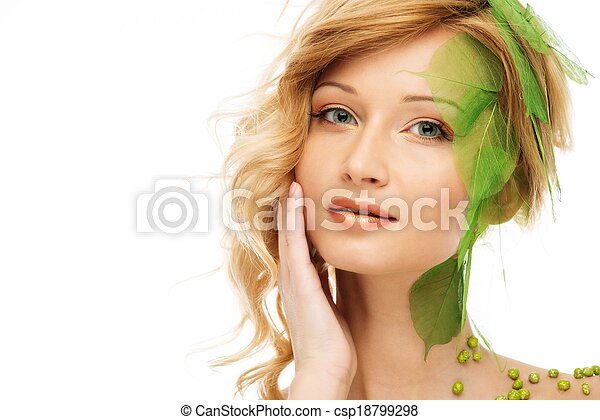 Beautiful young woman in conceptual spring costume touching her face  - csp18799298