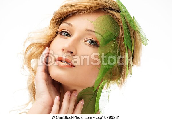 Beautiful young woman in conceptual spring costume touching her face  - csp18799231