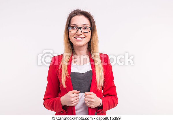 Beautiful young woman in red jacket and glasses - csp59015399