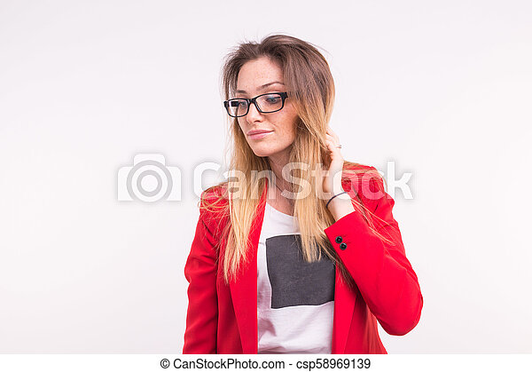 Beautiful young woman in red jacket and glasses - csp58969139