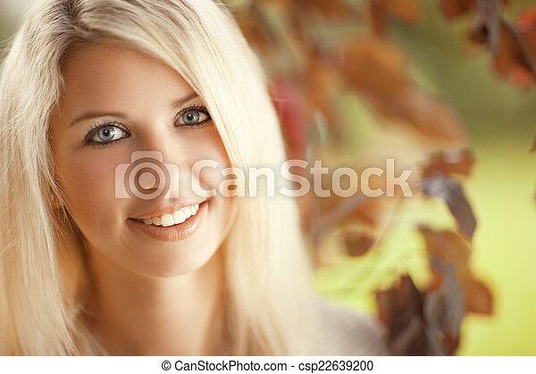 Beautiful young woman in the garden - csp22639200