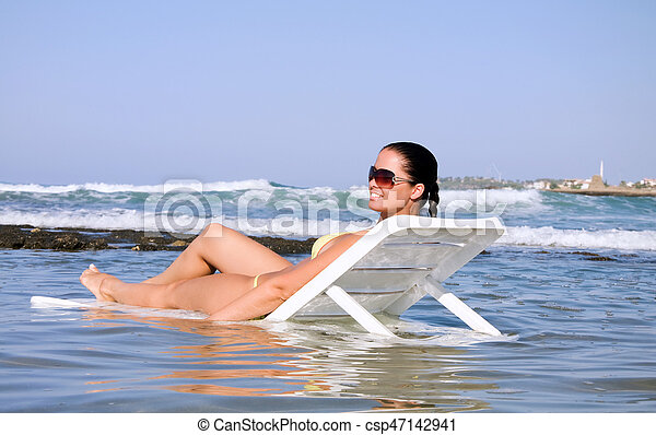 Beautiful young woman in the water - csp47142941