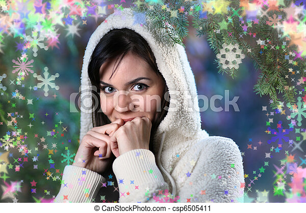 Beautiful young woman in winter forest - csp6505411