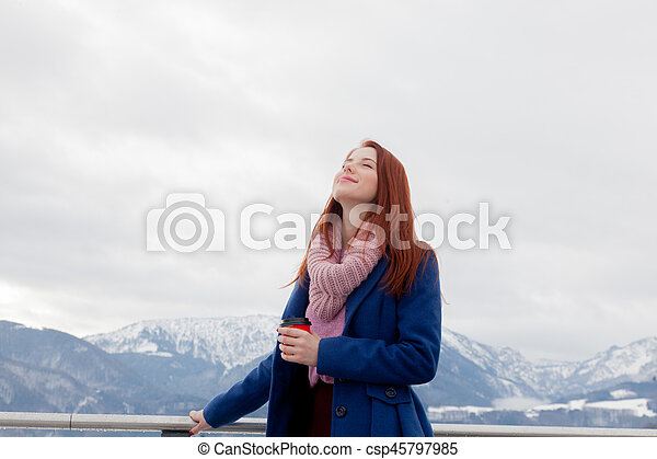 beautiful young woman on the mountains background - csp45797985