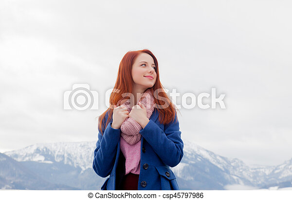 beautiful young woman on the mountains background - csp45797986