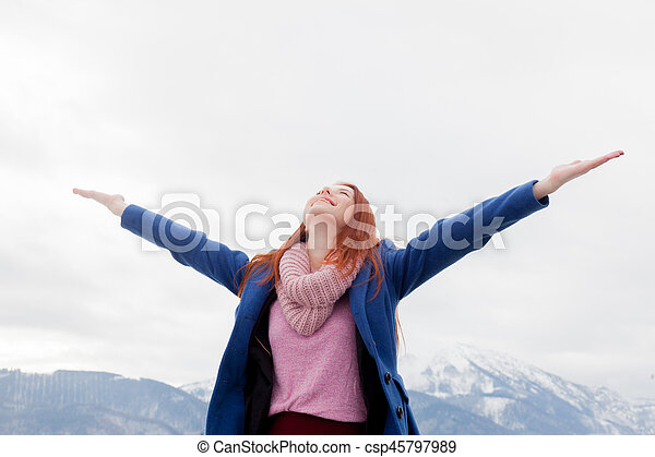 beautiful young woman on the mountains background - csp45797989