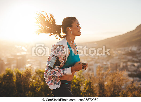 Beautiful young woman out for a run - csp28572989