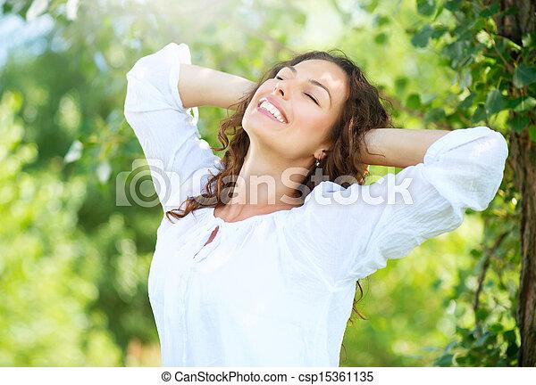 Beautiful Young Woman Outdoor. Enjoy Nature  - csp15361135