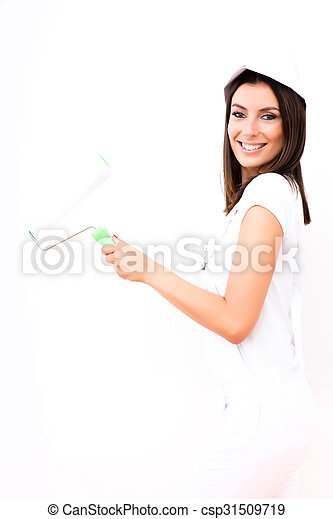 Beautiful young woman painting a Apartment - csp31509719