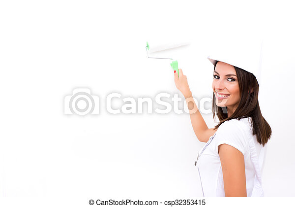 Beautiful young woman painting a Apartment - csp32353415