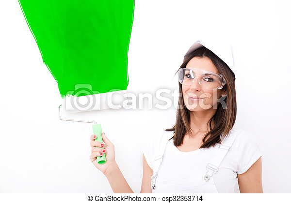Beautiful young woman painting a Apartment - csp32353714