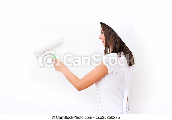 Beautiful young woman painting a Apartment - csp35250275
