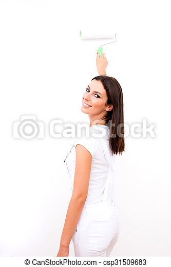 Beautiful young woman painting a Apartment - csp31509683