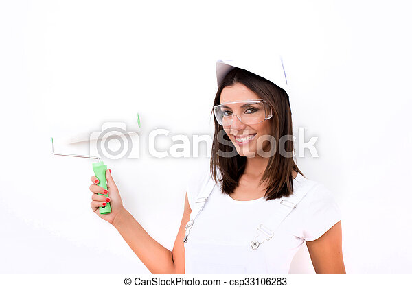 Beautiful young woman painting a Apartment - csp33106283