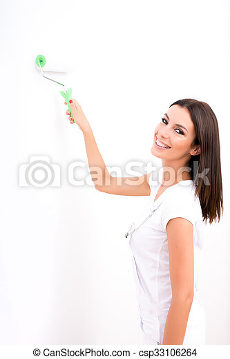 Beautiful young woman painting a Apartment - csp33106264