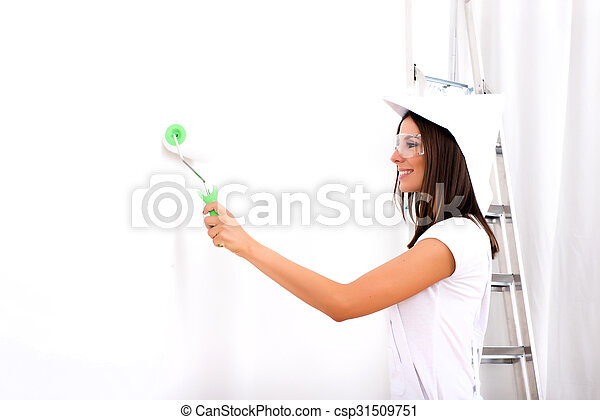 Beautiful young woman painting a Apartment - csp31509751
