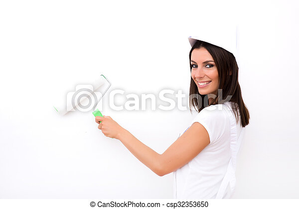 Beautiful young woman painting a Apartment	 - csp32353650