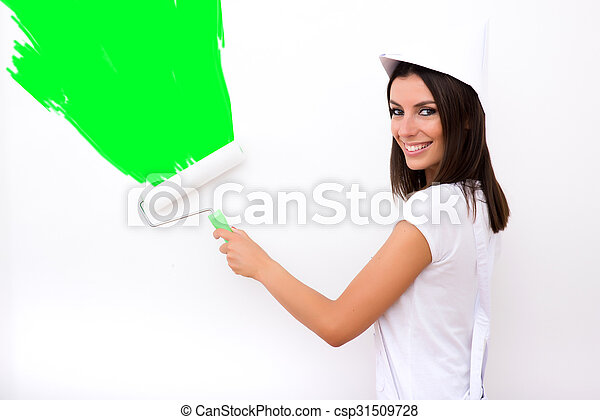 Beautiful young woman painting a Apartment - csp31509728
