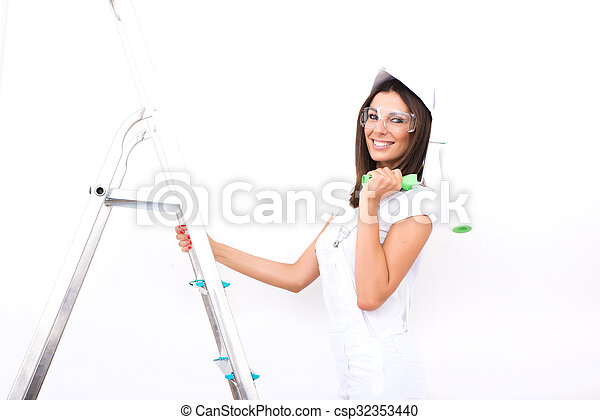 Beautiful young woman painting a Apartment - csp32353440