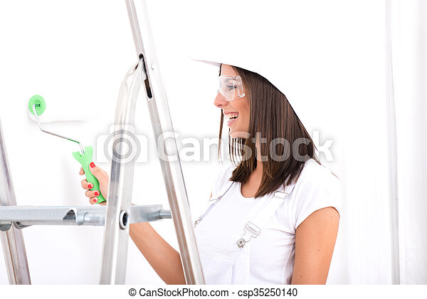 Beautiful young woman painting a Apartment - csp35250140