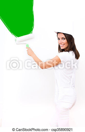 Beautiful young woman painting a Apartment - csp35890921