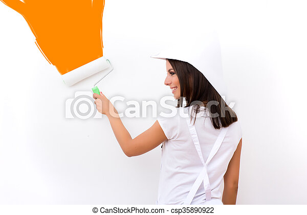 Beautiful young woman painting a Apartment - csp35890922