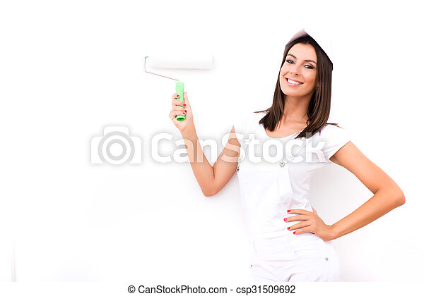 Beautiful young woman painting a Apartment - csp31509692