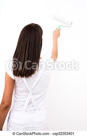 Beautiful young woman painting a Apartment - csp32353401